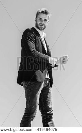 Confident Handsome Businessman. Handsome Man Fashion Model. Handsome Guy Posing In Formal Suit Blue