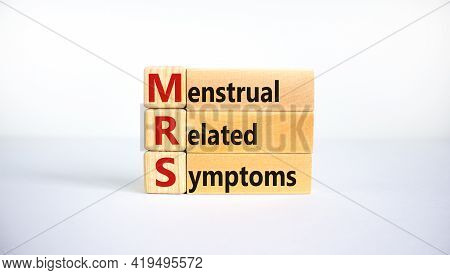 Medical And Mrs, Menstrual Related Symptoms Symbol. Wooden Blocks With The Word 'mrs, Menstrual Rela