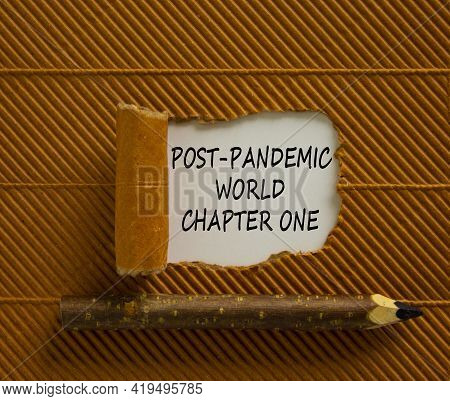 Post-pandemic World Symbol. Words 'post-pandemic World Chapter One' Appearing Behind Torn Brown Pape