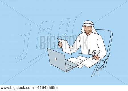 Private Plane And Luxury Life Concept. Young Smiling Businessman From United Arab Emirates Fsitting