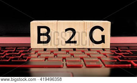 Cubes And Dice With Acronym B2g Business To Government.