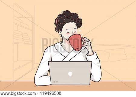 Remote Distant Work And Freelance Concept. Young Woman In Curlers Sitting Near Laptop And Home And D