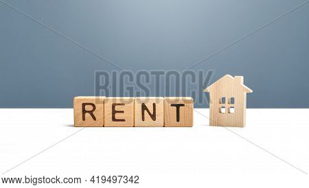 Wooden House And The Word Rent. Search For Home Rental. Realtor Services. Renting Out Of Housing And