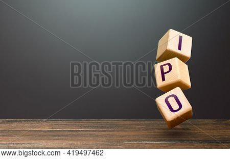 Tower Of Blocks With Word Ipo. Listing Entry Of A Business To Stock Exchange Using Initial Public Of