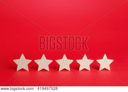 Five Stars On A Red Background. Rating Evaluation Concept. Service Quality Feedback. High Satisfacti