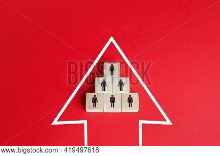 Business Team Group Of People Made Of Blocks In The Direction Arrow. Teamwork. Movement In A Single