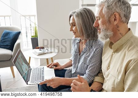 Senior Mature Family Couple Getting Online Telemedicine Call Consultation With Virtual Doctor Using