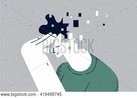 Memory Loss And Dementia, Brain Damage Concept. Profile Of Sad Man Losing Parts Of His Head As Symbo