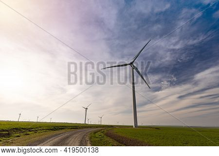 Windmills For Electric Power Production. Renewable Energy Concept