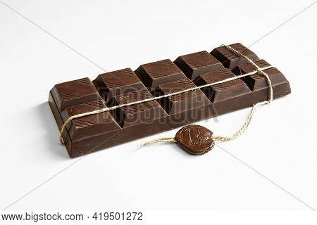 Chocolate. Exquisite chocolate bar close-up. On a white background.