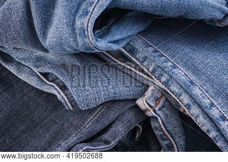 A Crumpled Denim Jeans Background. Close Up.