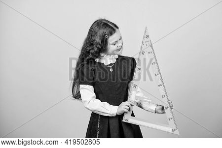 School Student Learning Geometry. Pupil Girl With Big Ruler. Math Lesson. Education And Knowledge. S