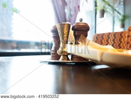 Different Seasonings In Oriental Style On A Wooden Table Against The Background Of A Window In A Res