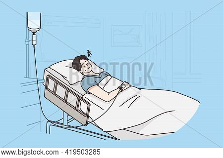 Healthcare And Medicine Concept. Sick Sad Unhappy Young Man Cartoon Character Attached To Intravenou