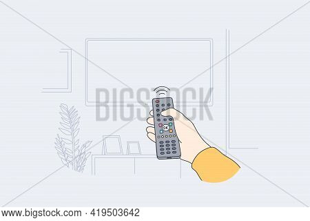 Television, Home Entertainment Concept. Human Hand With Tv Remote Control Switching Television On At
