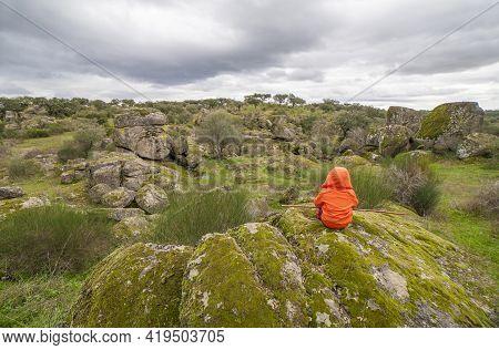 Child Boy Observing Spectacular Granitic Landscape Of Cornalvo Natural Park, Extremadura, Spain