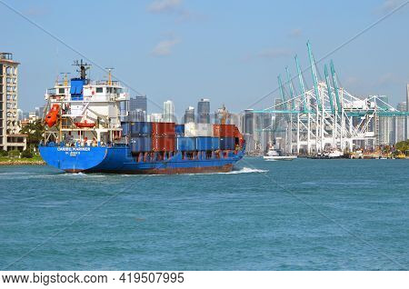 Miami,florida,u.s.a. 23 April 2021,container Ship Approaching Loading Piers At The Port Of Miami,