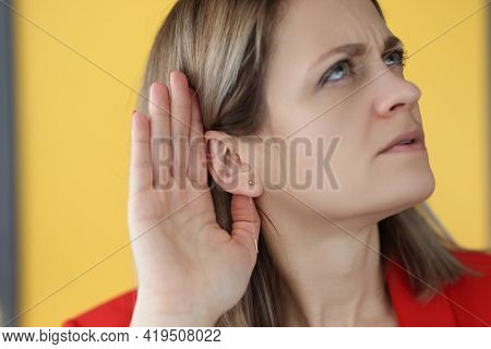 Woman Holds Her Hand Near Her Ear To Hear Better