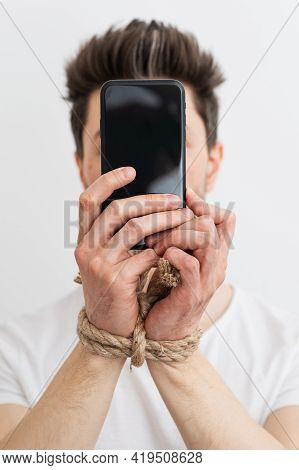 A Person With His Hands Tied Holding A Smartphone, Internet Addiction, Or Social Media Addiction.
