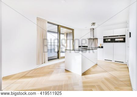 Interior Of Modern Kitchen In Minimal Style With Island Counter And Sink In Contemporary Flat