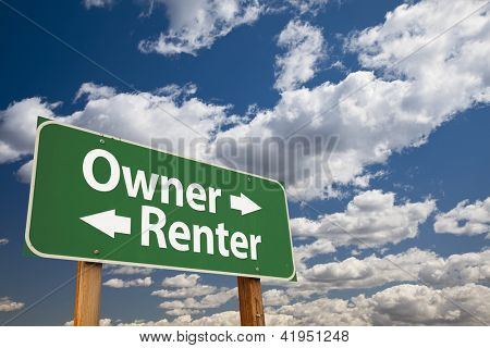 Owner, Renter Green Road Sign Over Dramatic Clouds and Sky.