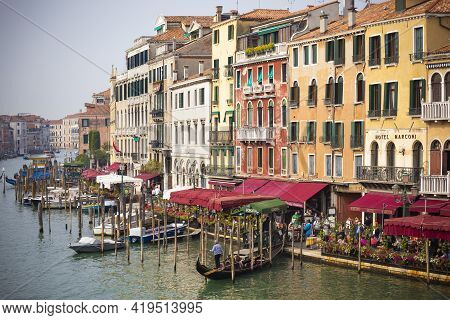 Venice, Italy - September 23, 2017: Gondolas And Boats Along The Picturesque Building Facades On The