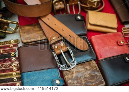 Different Hand Made Leather Man Accessories On Wooden Background.