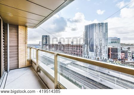 View From Balcony Of Amazing Cityscape With Modern Apartment Buildings In District Under Blue Cloudy