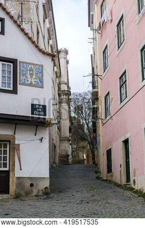 Small Street In The Alfama District With The Oldest Houses In The City Of Lisbon, Portugal