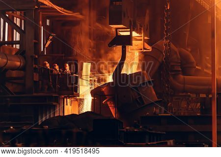Molten Iron Pouring From Ladle Container Into Mold, Workers Control Process, Steel Foundry Factory,