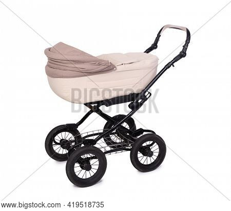 Biege baby carriage, stroller on wheels isolated over white background