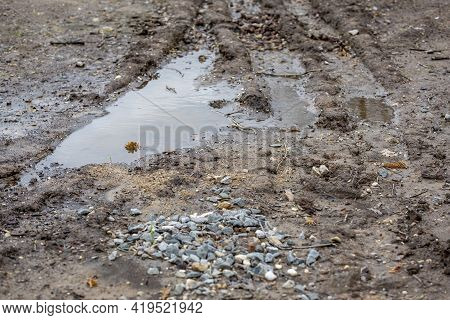 A Huge Puddle In The Countryside. Road After Rain
