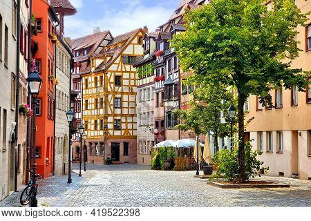 Beautiful Street Of Half Timbered Buildings In The Picturesque Old Town Of Nuremberg, Bavaria, Germa
