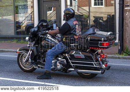 Annapolis, Md, Usa 05-02-2021: An African American Man With  Beard Wearing Jeans, Converse Shoes, Ve