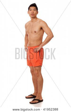 Young man in swimwear. Studio shot over white.