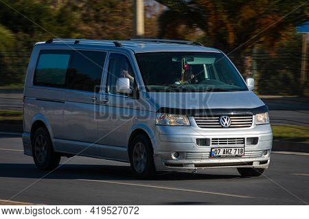 Alanya, Turkey  - April 17  2021:    Silver Volkswagen Transporter    Is Driving Fast On The Street