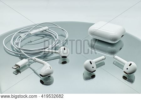 Bologna - Italy - April 27, 2021: Different Systems Of Apple Inc. Earphone: Air Pods Wireless With C