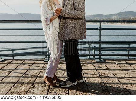 Cheerful senior couple dancing on Santa Monica Pier