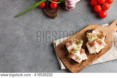 Two Bread Slices With Salted Pork Bacon Or Lard, Traditional Snacks To Ukrainian Borscht. Copy Space