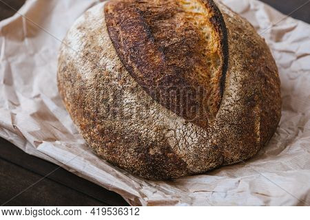 Close-up Hot Rye Circle Bread With Crispy Crust On A Craft Package