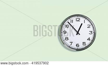 Plain Wall Clock On Pastel Green Banner