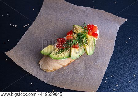 Canape - A Slice Of Crispy Baguette With Slices Of Ripe Avocado And Slices Of Juicy Tomato, Sprinkle