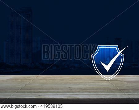Security Shield With Check Mark Flat Icon On Wooden Table Over Modern Office City Tower And Skyscrap