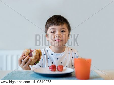 Kid Eating Whole Grain Bagels For His Breakfast,school Boy Eating Donut Healthy Child Eating Bread A