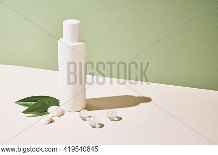 Beaty Product Package. Cosmetic Bottle On Pastel Green Background. Cosmetics Mock Up