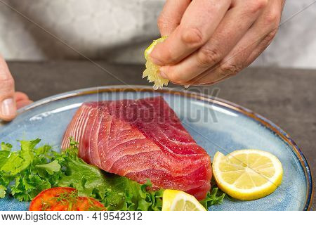 Cooking Tuna Steak In Home Kitchen. Online Cooking Recipe Concept, Fish Cooking At Home