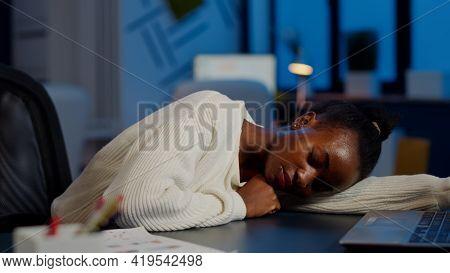 Dark Skin Freelancer Working Overtime Falling Asleep With Hand On Desk