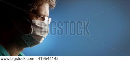 Portrait of medical doctor on blue background.
