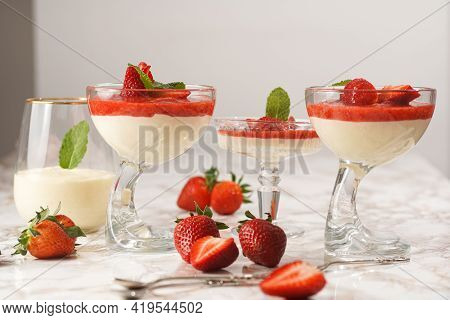 Several Glasses With Traditional Creamy Pudding Dessert Panna Cotta With Peppermint And Strawberry J