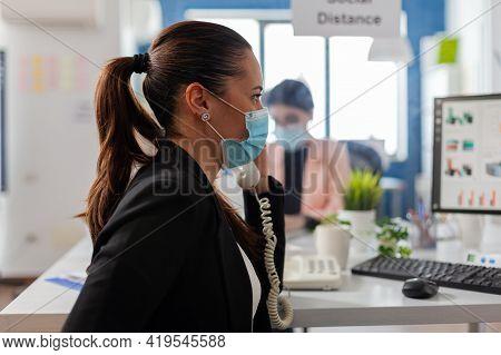 Businesswoman Having A Conversation On Landline Phone